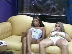 Catia Carvalho and Valeska Lins are on a chat show and posing