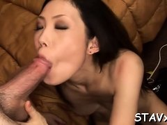 Oriental in fishnet nylons gives lascivious blow job job