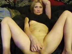 Blonde toys herself on the bed while he films and touches her ass
